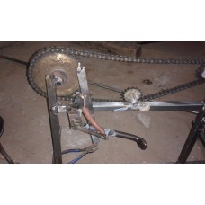 Automatic sprocket side stand remover